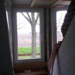 Geplaatste dakkapel en afwerking van de binnenruimte